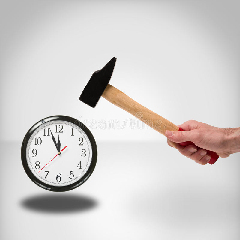 Hammer and clock. Concept of hammer striking a clock to manage time royalty free stock photography