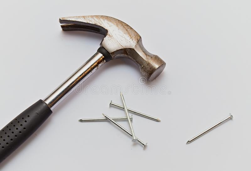 Hammer and construction nails on isolated white background, close-up royalty free stock photos
