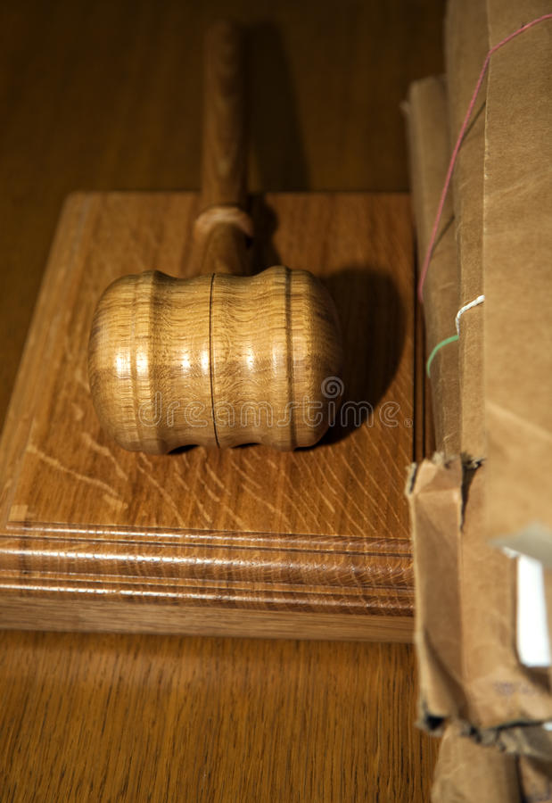 Hammer in the court. Table in the courthouse royalty free stock photos