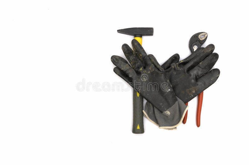 Hammer, gloves, parrot beak plier. royalty free stock photo