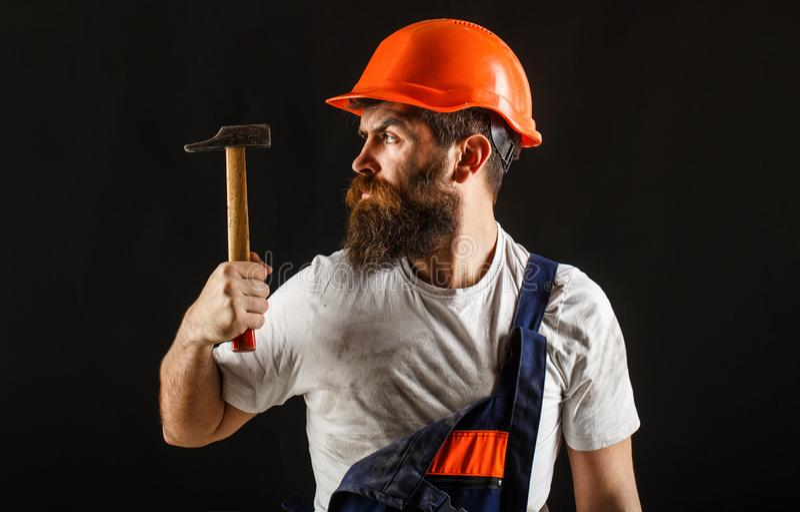 Hammer hammering. Builder in helmet, hammer, handyman, builders in hardhat. Handyman services. industry, technology royalty free stock photography