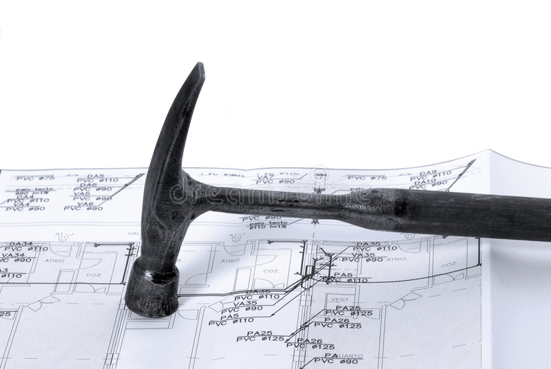 Hammer and house plan. For construction or reconstruction royalty free stock images