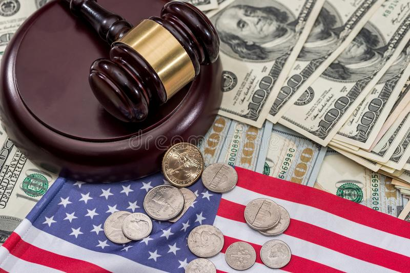 Hammer of judge of the dollar and the US flag.  royalty free stock photo
