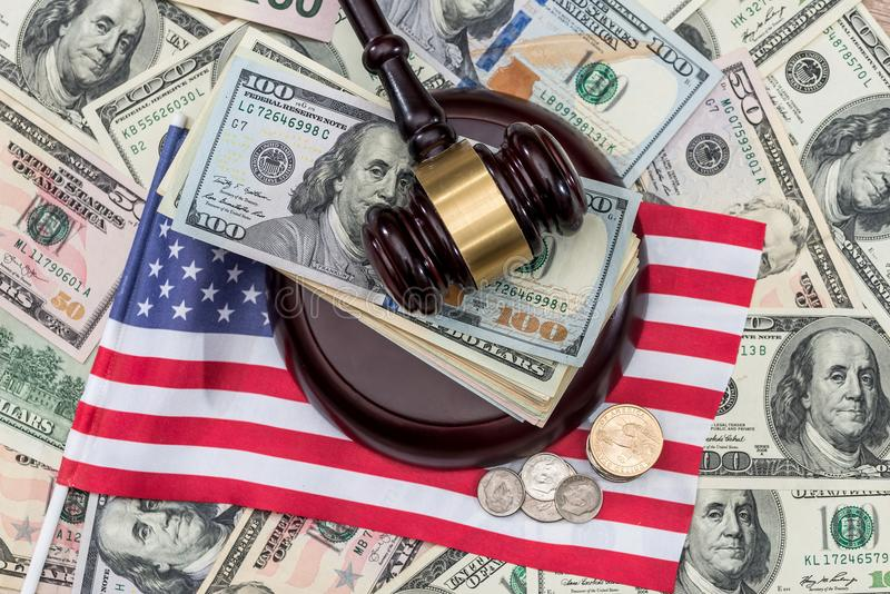 Hammer of judge of the dollar and the US flag.  royalty free stock photos