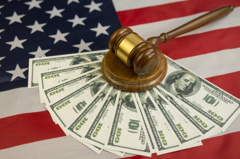 Hammer of the judge, dollars of money for the flag of the United States of America. The court, the law. Crime and Punishment. Business, corruption, bribe stock photo