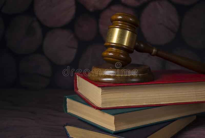 Hammer of the judge on the old books, retro background. royalty free stock photography