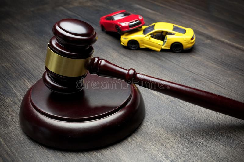 Hammer of the judge and two collided cars, accident, stock photo