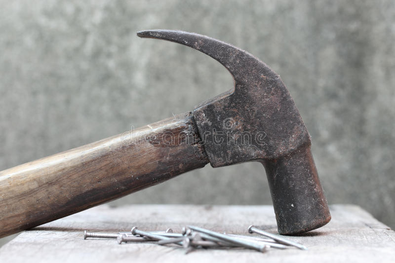 Hammer and many nails on wooden.  stock images