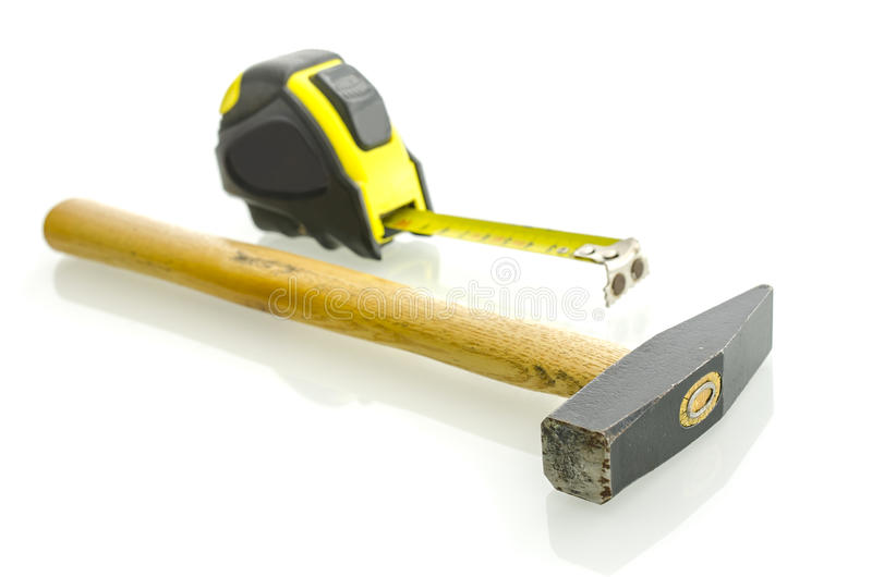Hammer And Measuring Tape Stock Images