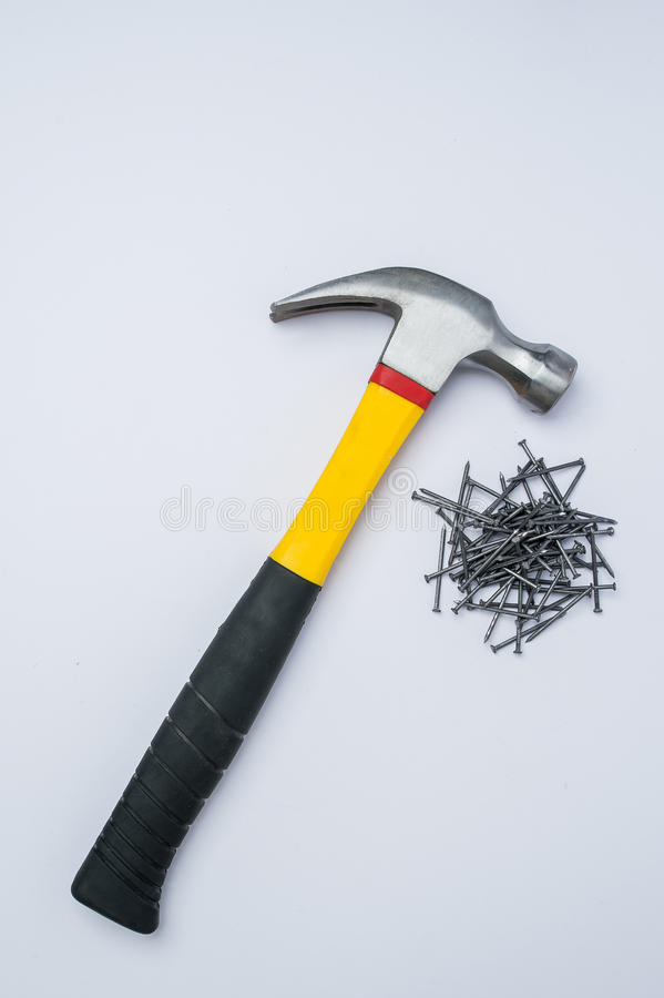 Hammer and metal nails on a white background royalty free stock images