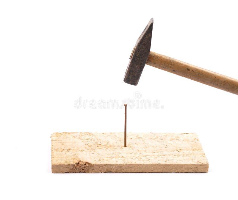 hammer mit nagel und brett stockbild bild von funktion 57218947. Black Bedroom Furniture Sets. Home Design Ideas