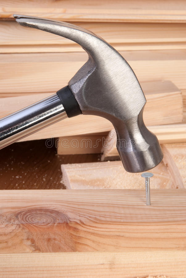 Hammer and nail stock image