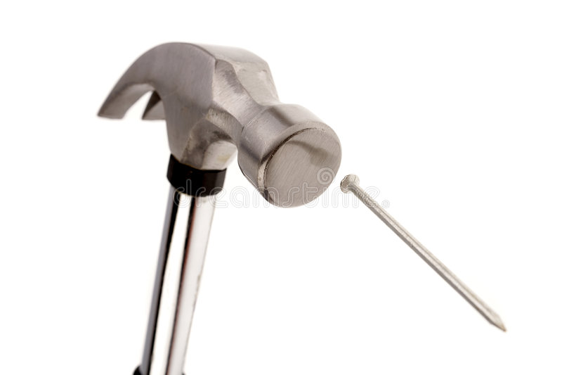 Hammer and nail royalty free stock photo