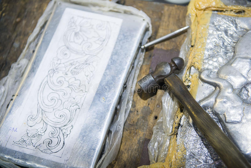Hammer and nail for craft the silverware royalty free stock images