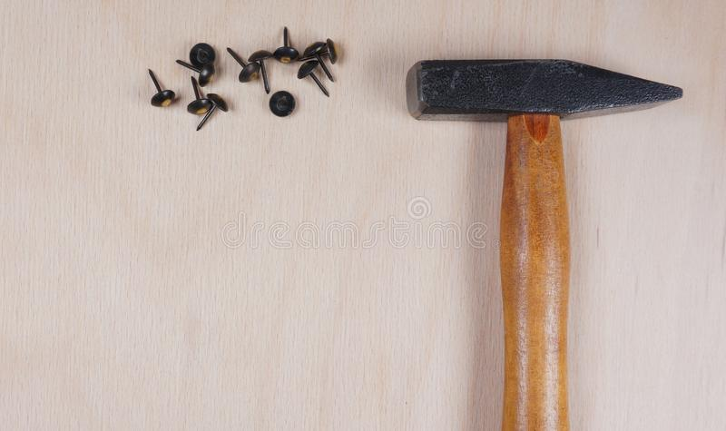 Hammer and nails at wooden background with space for your own text for an invitation for a workshop, fathersday, etc royalty free stock image