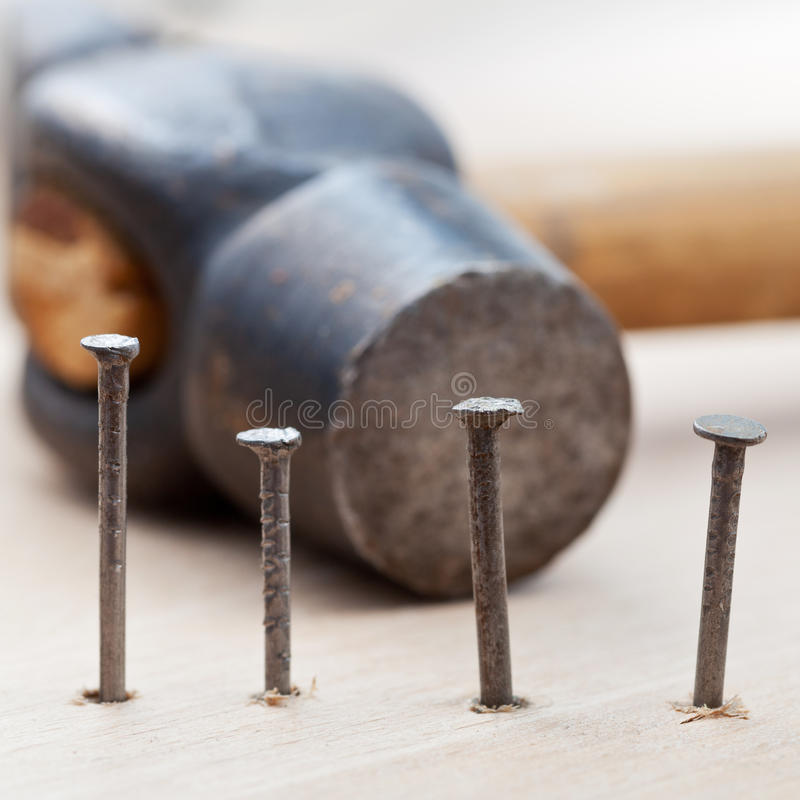 Download Hammer And Nails Into Wooden Plank Stock Image - Image: 33662413