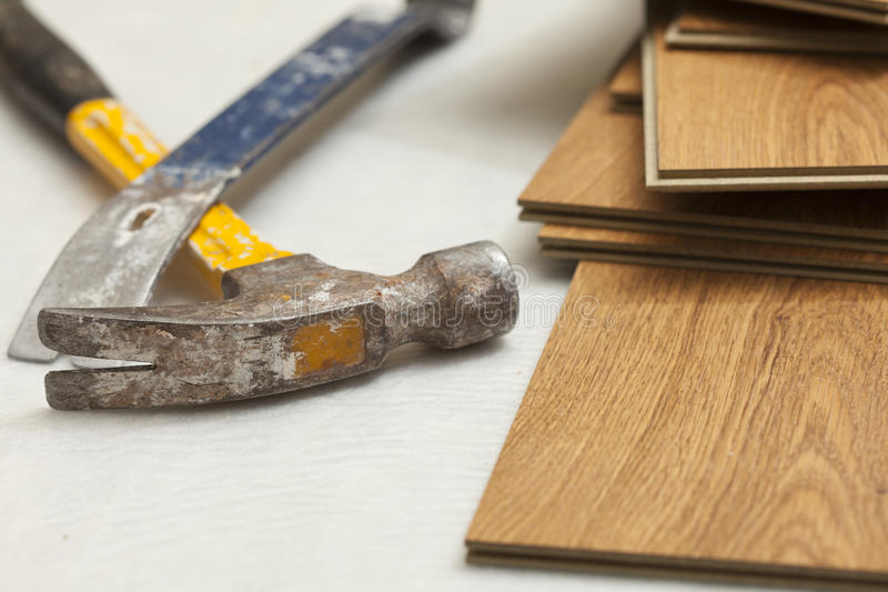 Hammer and Pry Bar with Laminate Flooring Abstract stock photo