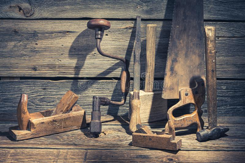 Hammer, saw and chisel on rustic wooden table stock image