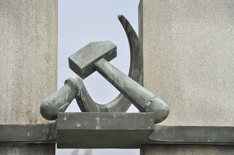 Hammer & Sickle. Statue of hammer and sickle is a part of the Soviet WWII monument at the cemetery in Terezin, Czech Republic stock images