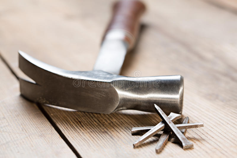 Hammer on table royalty free stock image