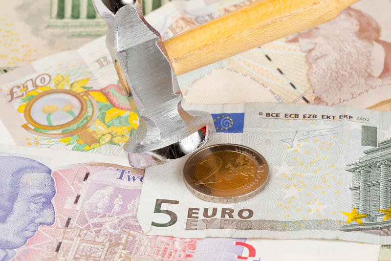 Hammer On Top Of Euro Note Stock Photography