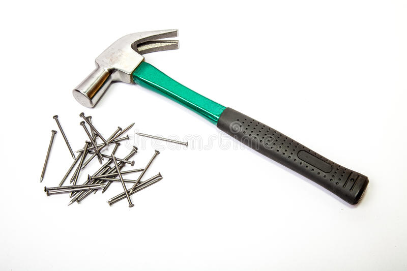 Hammer with wood nails royalty free stock photo