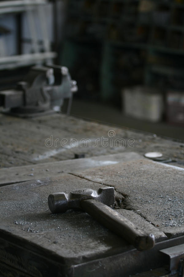 Hammer in a work bench stock photos