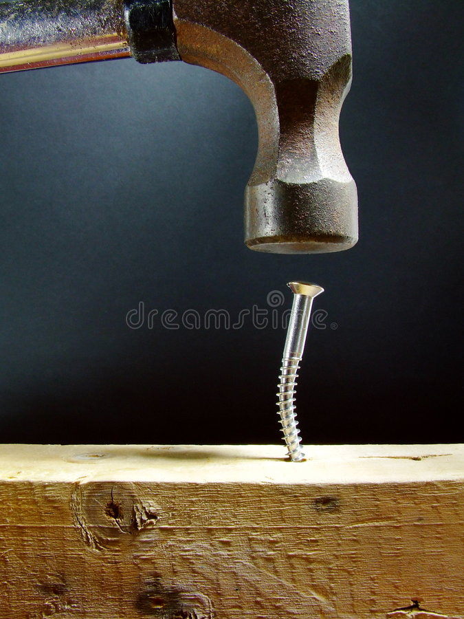Hammering a stock images