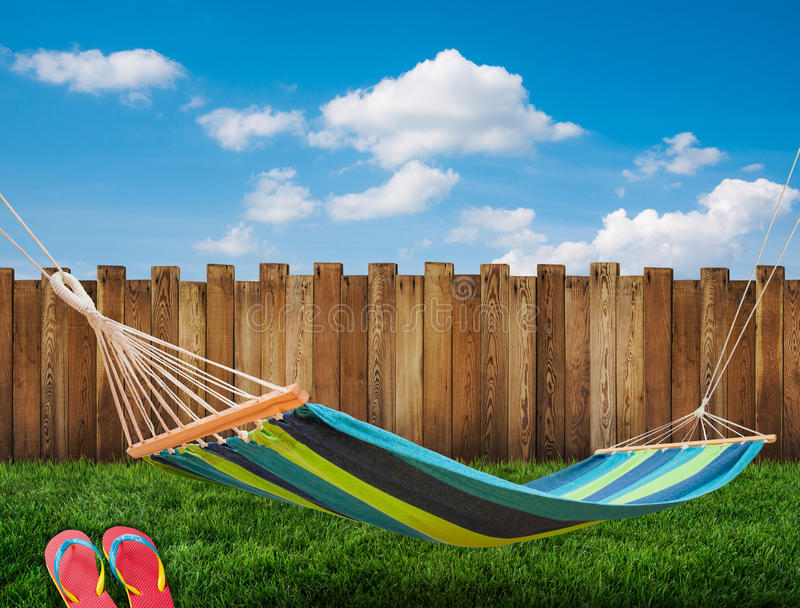 Hammock in backyard. Relaxing on hammock in backyard stock photography