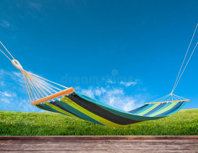 Hammock in backyard. Relaxing on hammock in backyard royalty free stock photos