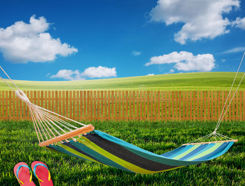 Hammock in backyard. Relaxing on hammock in backyard royalty free stock image