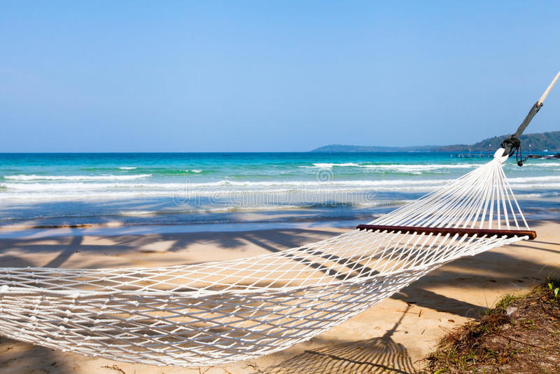 Hammock on the beach royalty free stock image