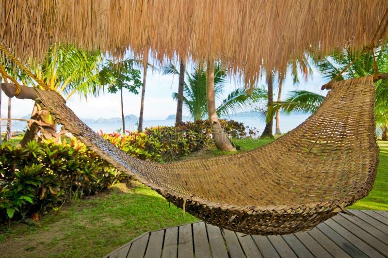 Hammock in Exotic Resort. Hammock in Exotic Tropical Palm Resort royalty free stock photos