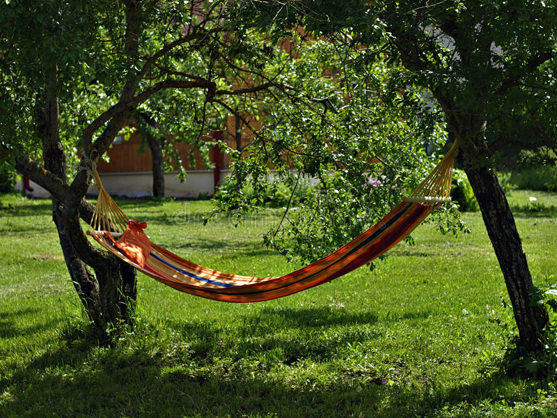 Hammock in the garden royalty free stock images