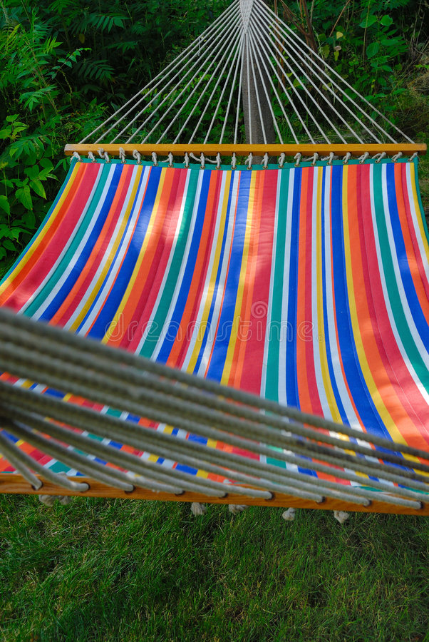 Hammock in garden. Colorful hammock in a backyard garden stock photos