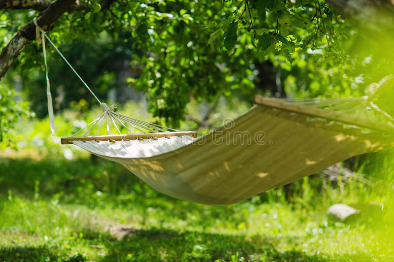Hammock in the garden shade for relaxation royalty free stock photos