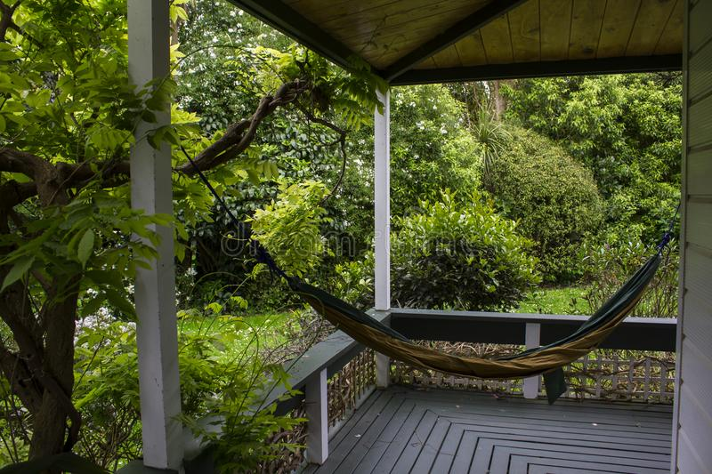 Hammock in house porch. Hammock in house front porch stock images