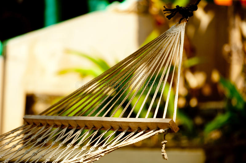 Hammock relaxation on beach and ocean. Tropic lounging Kerala India royalty free stock image
