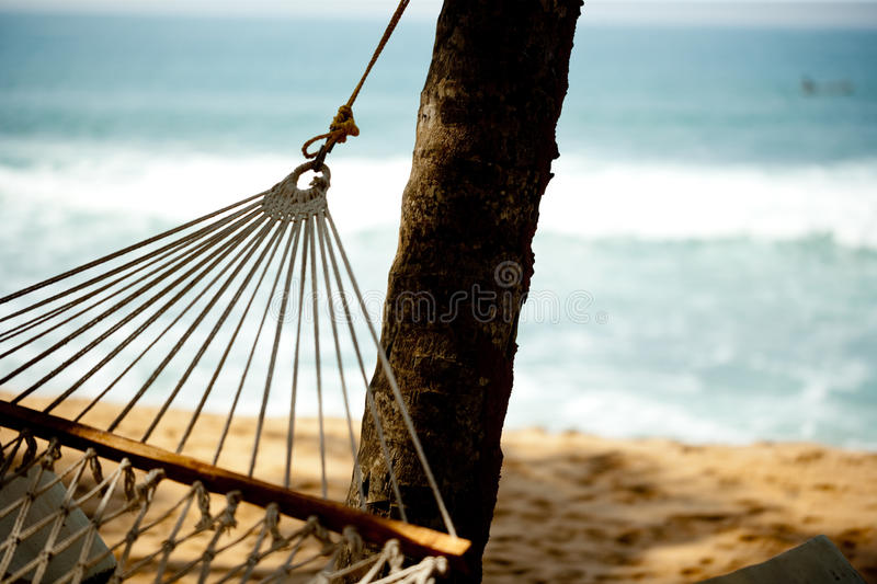 Hammock relaxation on beach and ocean. Tropic lounging Kerala India royalty free stock photography