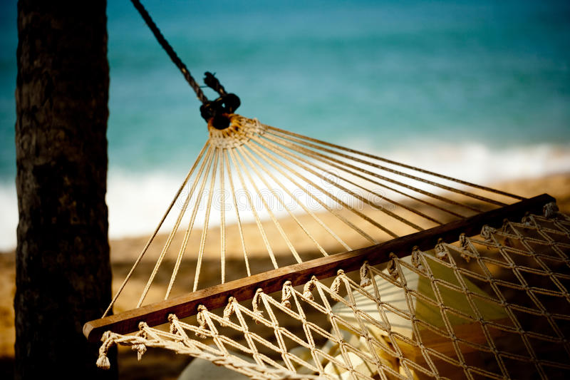 Hammock relaxation on beach and ocean. Tropic lounging Kerala India royalty free stock photo