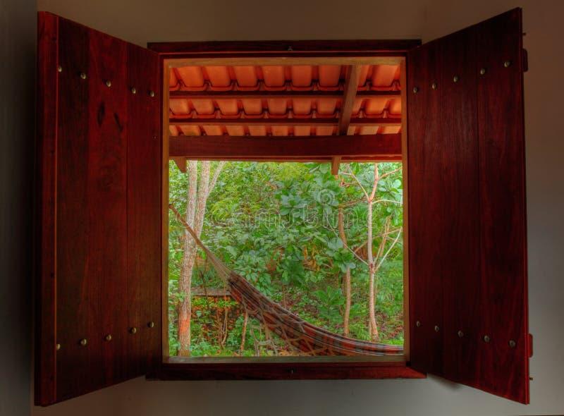 Hammock at tropical rain forest resort royalty free stock photos