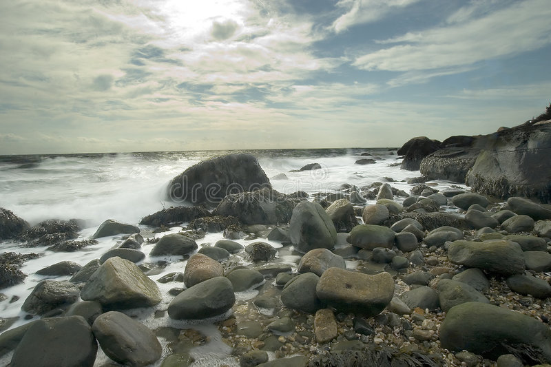 Hammonasset Beach State Park. A rocky beach with big sky and deep perspective royalty free stock photography