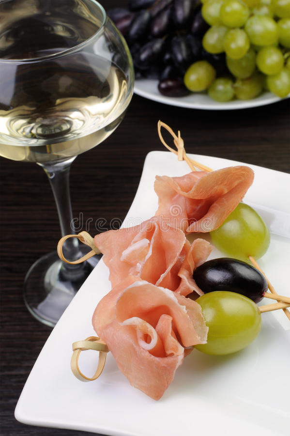 Hamon with grapes on a skewer stock photo