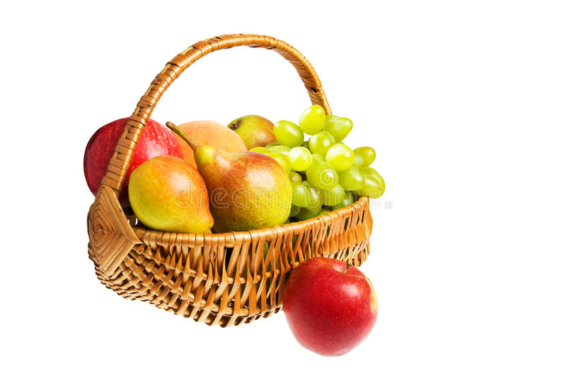 Hamper with fruits. Isolated on the white background royalty free stock photos