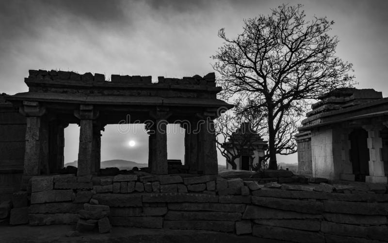 Hampi karnakata india temple and silhouette tree at sunset point black and white. Timeless royalty free stock photography