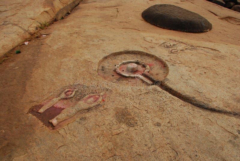 Hampi, Karnataka, India. Devotional rock carvings royalty free stock photo