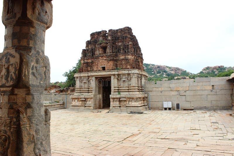 Hampi vittala temple. Main gopura of vittala temple at hampi half eroded royalty free stock image