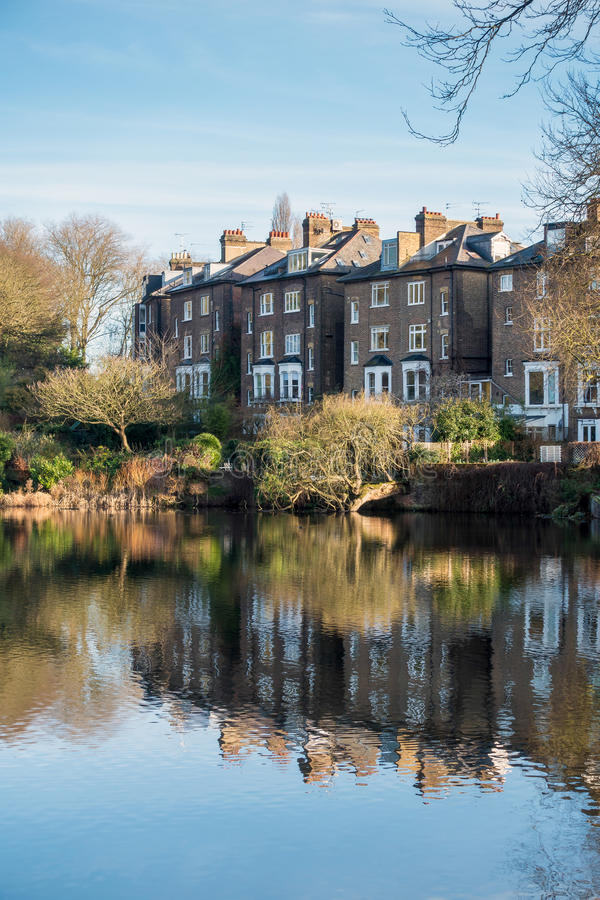 HAMPSTEAD, LONDON/UK - DECEMBER 27 : Row of Houses by a Lake at stock image