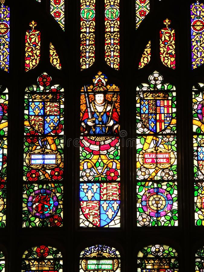 Hampton Court Palace. Stained glass window in the great hall stock image