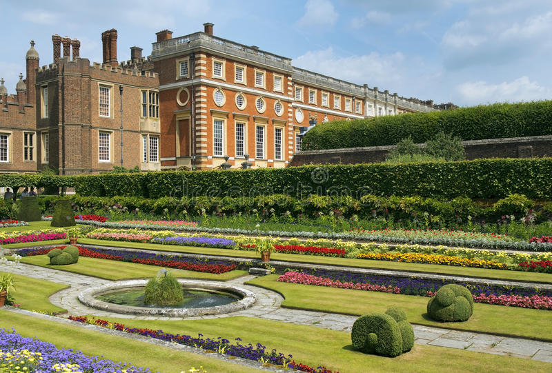 Hampton Court Palace. A magnificent example of landscape and gardening design, London, UK royalty free stock photo